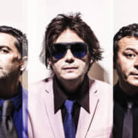The everlasting: Manic Street Preachers — (from left) Sean Moore, Nicky Wire and James Dean Bradfield — released their debut single in 1988, and the band has shown no sign of stopping since. | ALEX LAKE