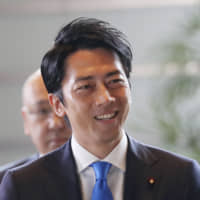 Fresh face: Newly appointed Environment Minister Shinjiro Koizumi arrives at the prime minister's official residence in Tokyo on Sept. 11.  AP   AP