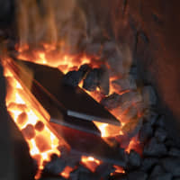 Fanning the flames: Pieces of steel are heated on charcoal in the forge. It takes keen perception to know when the steel has reached the ideal temperature. Supposedly when it takes on the color of sunset it has reached 850 degrees Celsius, but this is virtually impossible to recognize without a highly trained eye.