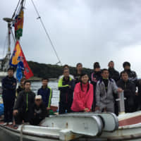 Chika Tsubouchi (front, center) leads groups of fishing fleets. | GHIBLI
