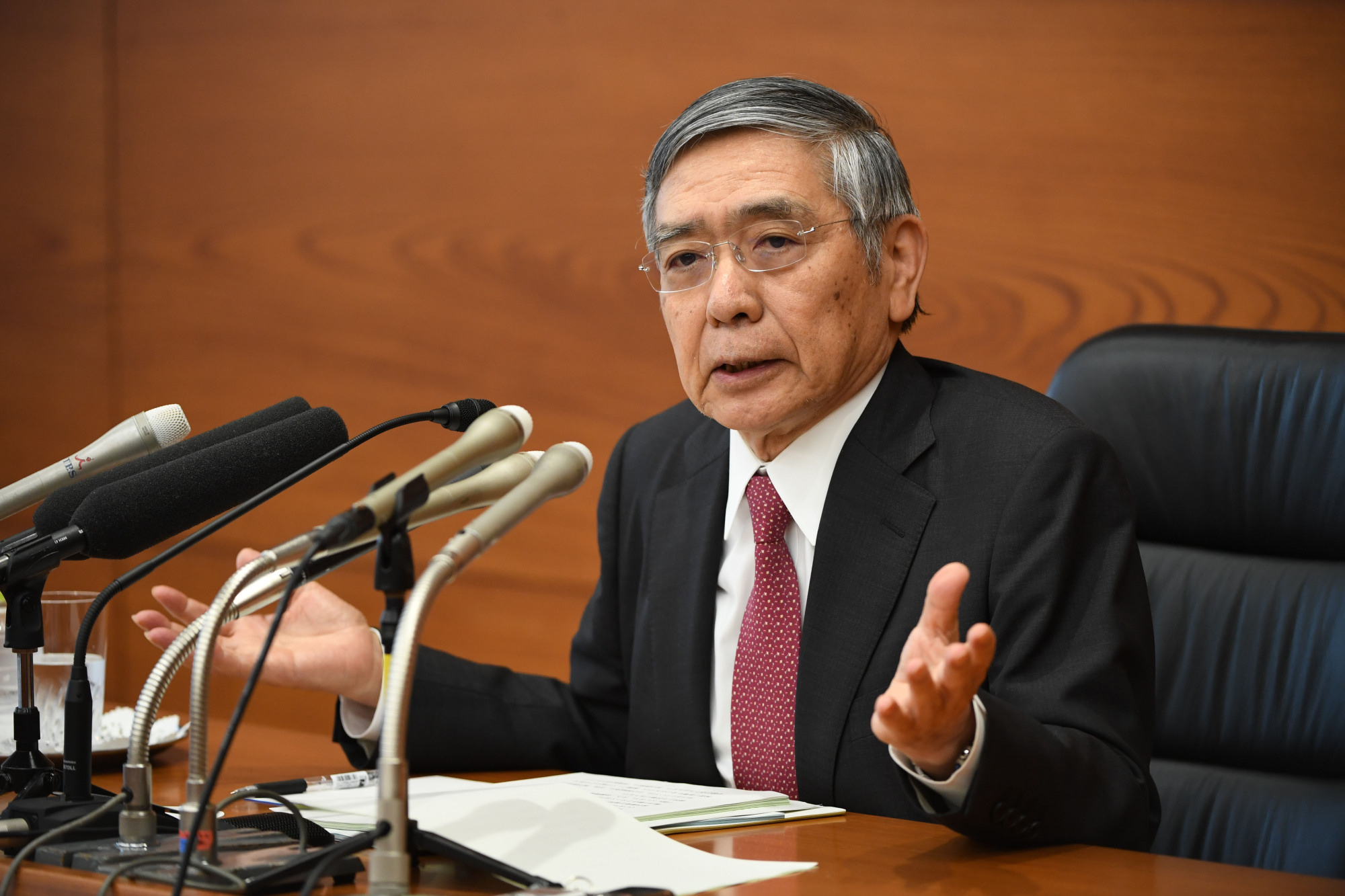 At a news conference Thursday following the Bank of Japan's latest Policy Board meeting, Gov. Haruhiko Kuroda hints at taking additional monetary-easing steps. | BLOOMBERG