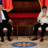 Since taking power in 2016, Philippine President Rodrigo Duterte, seen here meeting with Chinese President Xi Jinping in Manila last November, has chosen mostly to accommodate rather than resist Beijing's pressure. | REUTERS