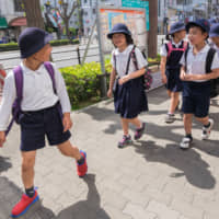 Japanese school children are taught to value conformity from an early age. | GETTY IMAGES