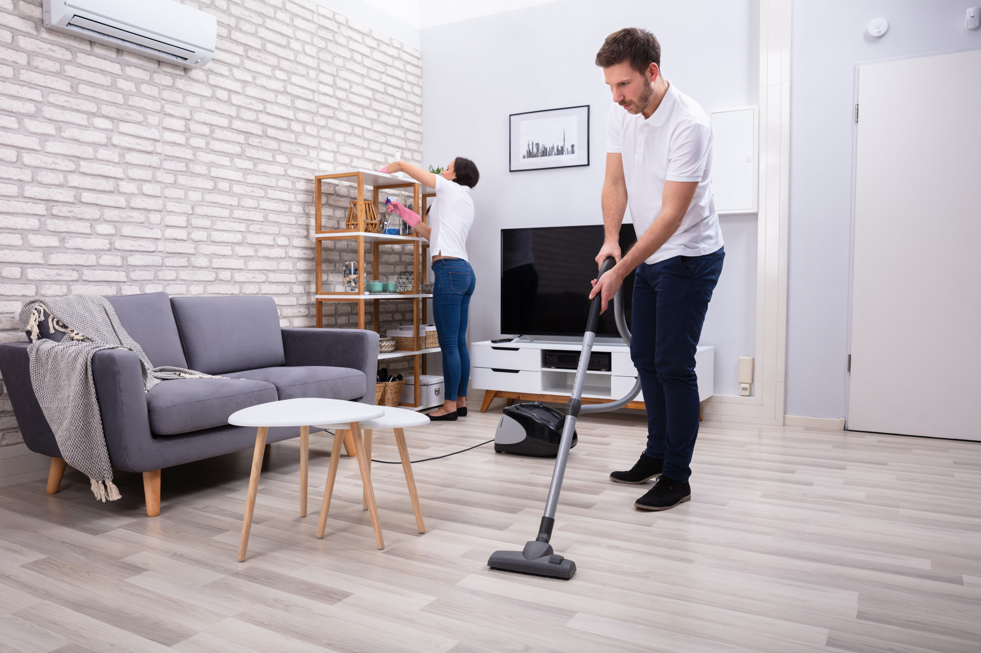 Married men help out with household chores far more now than their great-grandfathers did, but their wives still get stuck doing the lion's share of  housework. | GETTY IMAGES