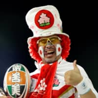 A Japanese fan poses at a Rugby World Cup warm-up game held in Saitama on Sept. 6.