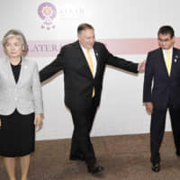 South Korean Foreign Minister Kang Kyung Wha, U.S. Secretary of State Mike Pompeo and then-Foreign Minister Taro Kono are seen after talks in Bangkok on Aug. 2 amid a heated dispute between Tokyo and Seoul over trade policy and wartime history. | KYODO