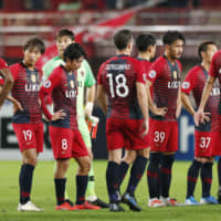 Antlers players react after being knocked out of the Asian Champions League on Wednesday in Kashima, Ibaraki Prefecture. | KYODO
