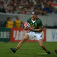 South Africa's Cheslin Kolbe scores a first-half try against Japan on Friday at Kumagaya Rugby Stadium. The Springboks trounced the Brave Blossoms 41-7. | DAN ORLOWITZ