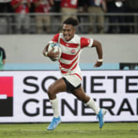 Japan's Kotaro Matsushima runs to score his third try of the game against Russia during the Rugby World Cup Pool A game at Tokyo Stadium on Friday night. | AP