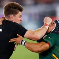 New Zealand's Beauden Barrett (left) attempts to run past South Africa's Cheslin Kolbe during their Pool B match at the Rugby World Cup on Saturday in Yokohama. | AFP-JIJI