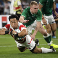 Japan's Kenki Fukuoka scores a try against Ireland on Saturday. | AP