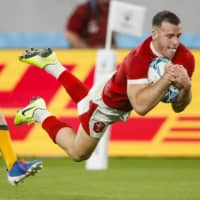 Wales holds off Australia comeback attempt to take control of Pool D in Rugby World Cup