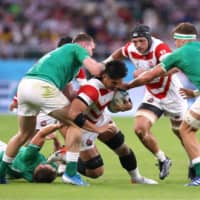 Japan's Kazuki Himeno carries the ball against Ireland in a Rugby World Cup Pool A match on Saturday at Shizuoka Stadium Ecopa. | REUTERS