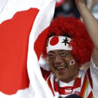 A fan cheers for the Brave Blossoms during Saturday's match. | REUTERS