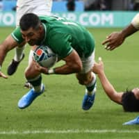 Ireland's Rob Kearney scores a first-half try against Japan on Saturday. | AFP-JIJI