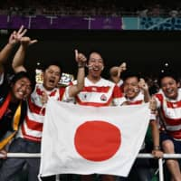Japan supporters celebrate after the Brave Blossoms defeat Ireland. | AFP-JIJI