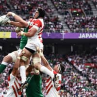 Japan's lock James Moore jumps for the ball in a lineout. | AFP-JIJI