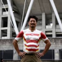 Hiroshi Moriyama poses Saturday outside Shizuoka Stadium Ecopa on the evening of the Japan vs Ireland Pool A game of the 2019 Rugby World Cup.