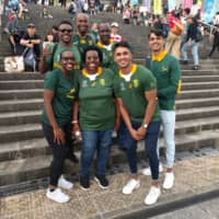 South African fans visiting from Pretoria soak up the atmosphere at International Stadium Yokohama before the Springboks' Rugby World Cup game against New Zealand on Saturday. | ANDREW MCKIRDY