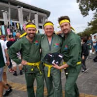 John Siccombe (left) and two of his colleagues get into the Rugby World Cup spirit before South Africa's game against New Zealand in Yokohama on Saturday. | ANDREW MCKIRDY