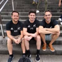 Dutch All Blacks fans (from left) Pascal Rijkers, Ben Wijnen and Johnny Nas show their colors ahead of Saturday's Rugby World Cup game against South Africa in Yokohama. | ANDREW MCKIRDY