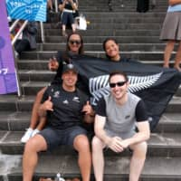 New Zealand fans (back, from left) Angela Johnson, Kahureremoa Hoko and (front left) Richard Johnson and Ireland fan Patrick McHugh get in the mood before Saturday's Rugby World Cup game in Yokohama. | ANDREW MCKIRDY