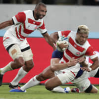 New Zealand-born Michael Leitch (left) and Lomano Lemeki are two of 16 foreign-born players representing Japan at the 2019 Rugby World Cup. | AP