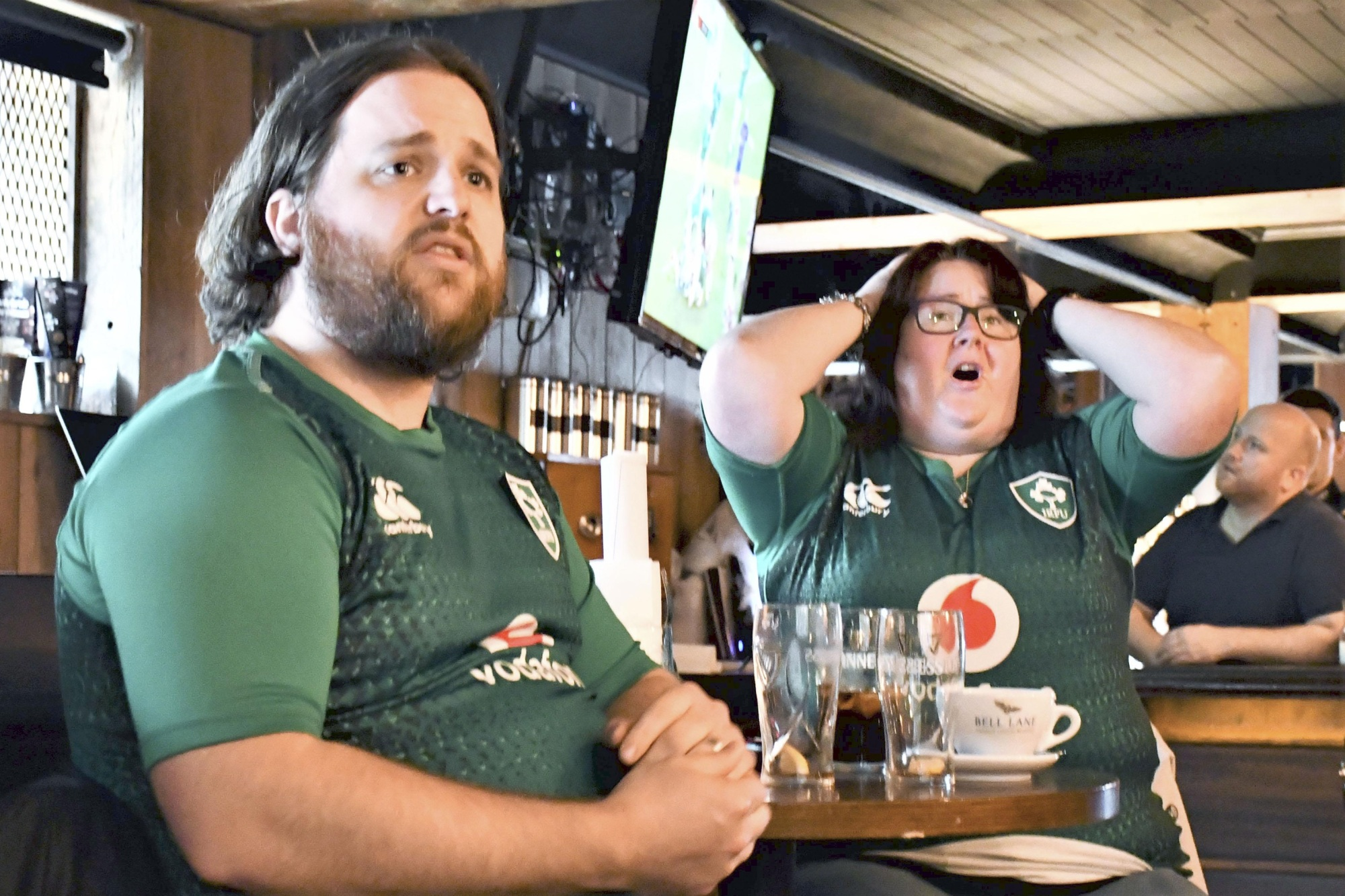 Ireland fans watch Saturday's Rugby World Cup match against Japan at a pub in Dublin. | KYODO