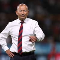 England coach Eddie Jones stands on the field before his team's game against Tonga during the Rugby World Cup on Sunday in Sapporo. | REUTERS