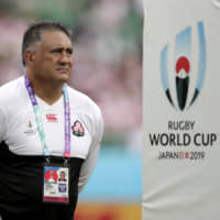 Japan coach Jamie Joseph watches his players from the field before the Brave Blossoms' Rugby World Cup game against Ireland on Saturday in Fukuroi, Shizuoka Prefecture. | AP