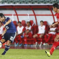 Japan's Shoya Nakajima scores a first-half goal against Myanmar in a World Cup qualifier on Tuesday in Yangon. | KYODO