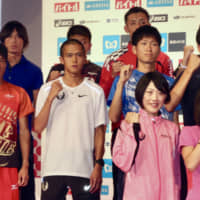Japan men's marathon record holder Suguru Osako (front row, second from left) and other MGC participants pose for photos at a Tokyo news conference on Friday. | KAZ NAGATSUKA