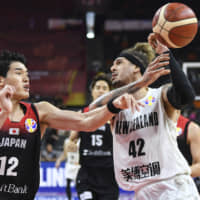Japan's Yuta Watanabe (left) defends New Zealand's Issac Fotu during their game at the FIBA World Cup on Saturday in Dongguan, China. | AP