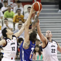 Japan's Yuta Watanabe (left) and Nick Fazekas (right) attempt to block a shot by the Czech Republic's Ondrej Balvin on Tuesday in Shanghai. | REUTERS