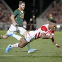 Japan's Kotaro Matsushima scores a try in the second half of a Rugby World Cup warmup match against South Africa in Kumagaya, Saitama Prefecture, on Friday. | KYODO