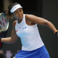 Naomi Osaka gets by Pegula to advance in China