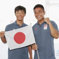 Keiju Okada and Jumpei Hokazono pose at a news conference after qualifying for the men's 470 sailing competition of the Tokyo Olympics on Sunday at Enoshima Yacht Harbor in Kanagawa Prefecture. | KYODO