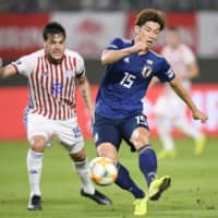 Japan sets tone with two first-half goals in victory over Paraguay