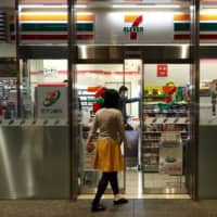 Some 7-Eleven convenience stores are having a tough time finding enough workers to operate 24 hours a day. | BLOOMBERG