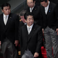 Abe rolls the dice on his political legacy with tax hike