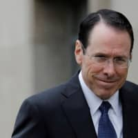 Chief Executive Officer of AT&T Randall Stephenson arrives at a U.S. District Court in Washington last year. | REUTERS