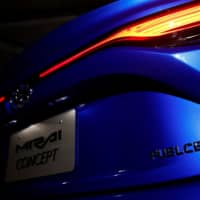 A fuel cell-powered Toyota Mirai is displayed at the Tokyo Motor Show on Thursday. | REUTERS
