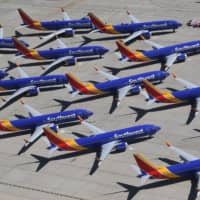 Southwest Airlines Boeing 737 Max aircraft are parked on the tarmac after being grounded, at the Southern California Logistics Airport in Victorville, California, in March.   AFP-JIJI