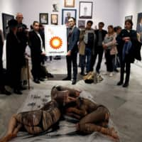 A crude performance: Semi-naked climate activists protest BP art sponsorship