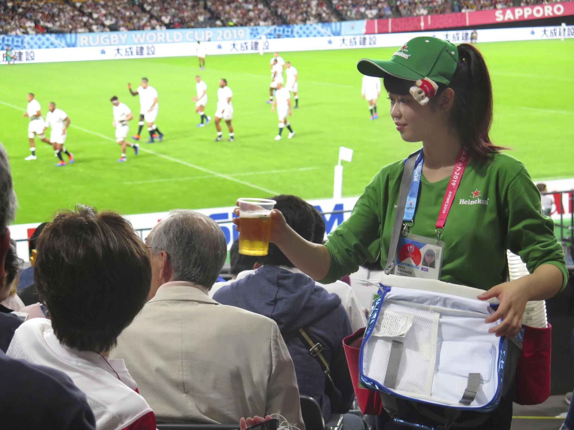 A vender serves beer to spectators of a Rugby World Cup match at the Sapporo Dome on Sept. 22. | KYODO