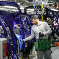 A Nissan Motor Co. executive says that if a 'no-deal' results in 10 percent duties on vehicles exported from the U.K. to the EU, it will create an enormous problem for the firm's European operations. | BLOOMBERG