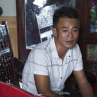 Vo Ngoc Chuyen, brother of Vo Ngoc Nam, speaks to media at his home in Yen Thanh district, Nghe An province, Vietnam, Sunday. Chuyen's family fear that Vo Ngoc Nam could be among the people who died in a container in the U.K. | AP