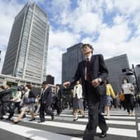The Cabinet Office estimates that a bilateral trade agreement between Japan and the United States will boost Japan's gross domestic product by around 0.8 percent. | BLOOMBERG