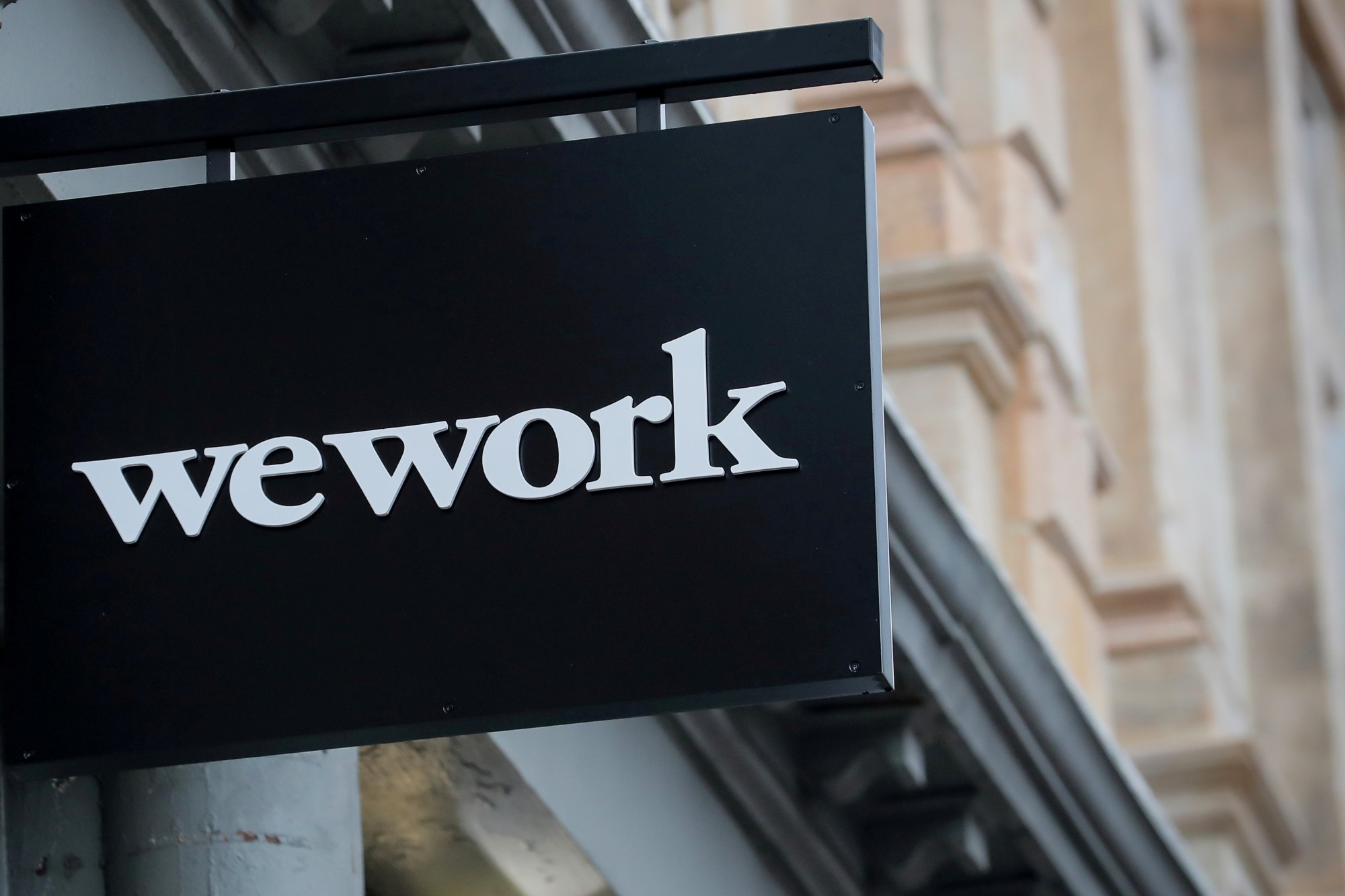 The WeWork logo is displayed outside of a co-working space in New York City in January.   REUTERS