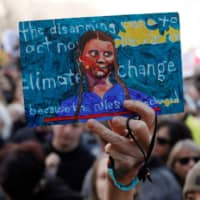 A demonstrator holds up a sign made for Swedish climate change teen activist Greta Thunberg during a climate strike march at the Alberta Legislature in Edmonton, Alberta on Thursday.   REUTERS
